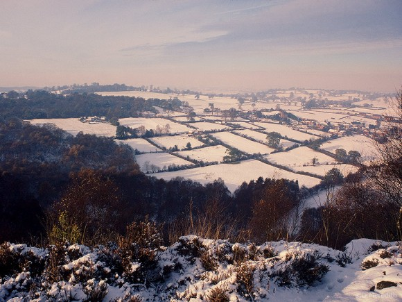 Snow on Cheshire plain from Bickerton Hill, Cheshire, England