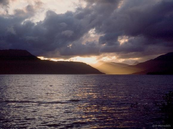 Light beams through storm clouds.