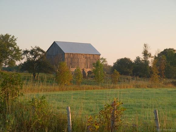An old barn at sunrise.