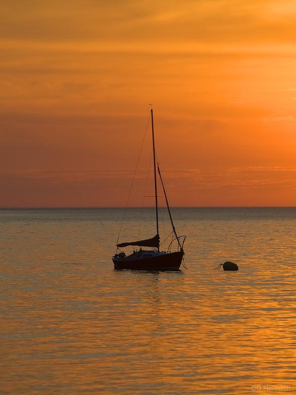 Sunrise and sailboat.