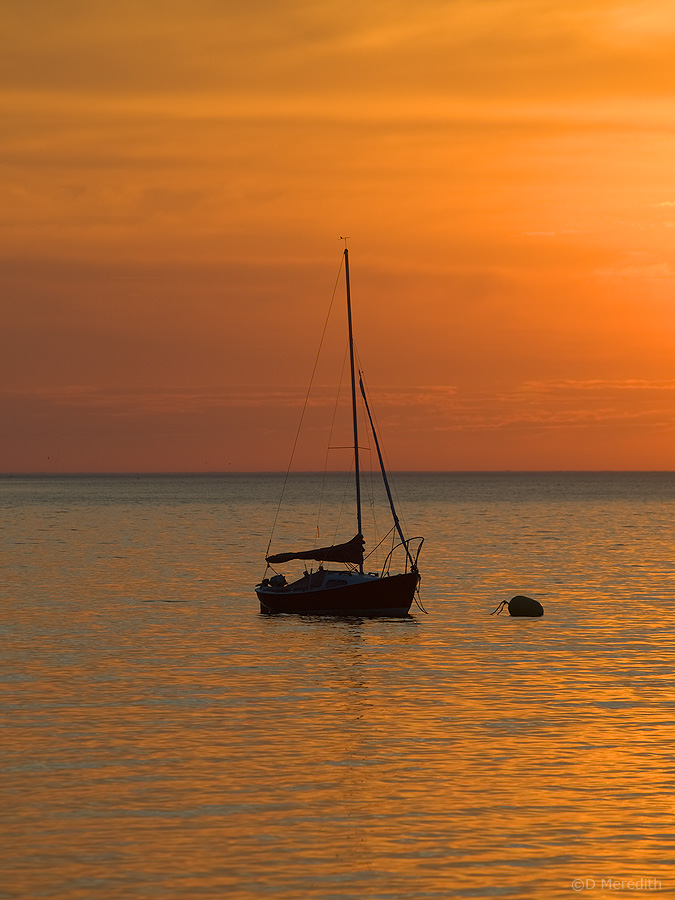 Sunrise and sailboat.