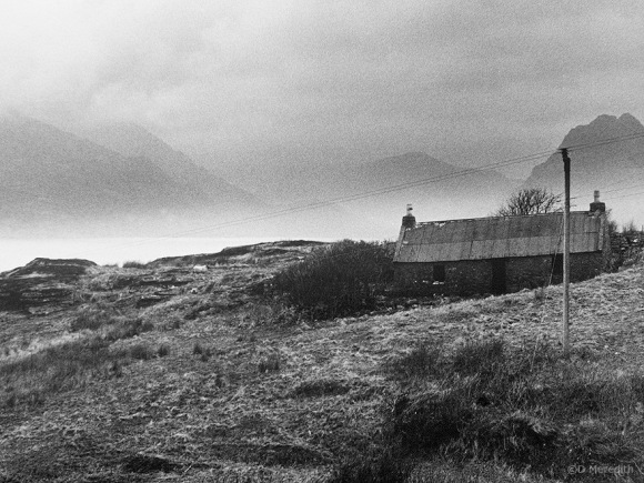 Abandoned cottage in front of the Cuillin.