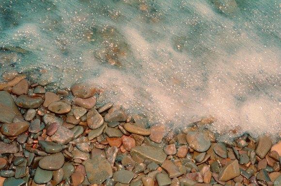 Wave on stones.