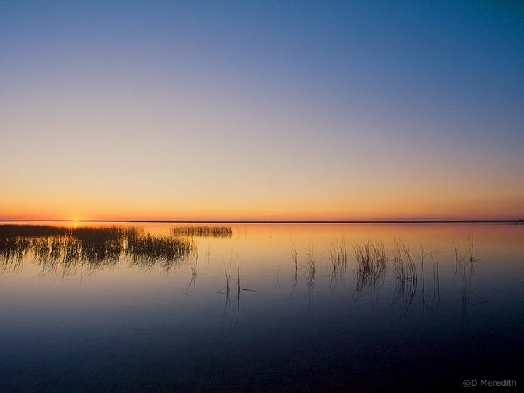The sun sets over Last Mountain Lake.
