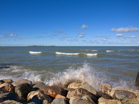 Wave breaking on rocks.