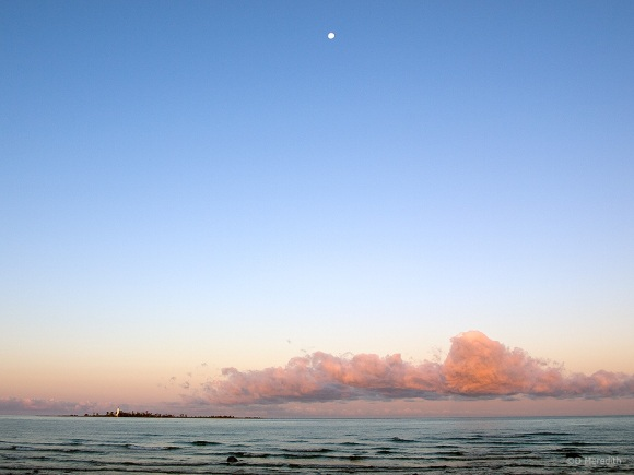 Moon and cloud at sunrise.
