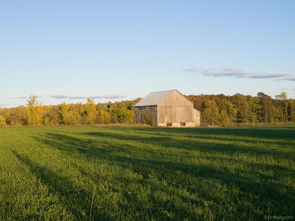 Old barn at sunset.