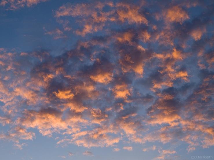 Sunrise illuminated clouds.