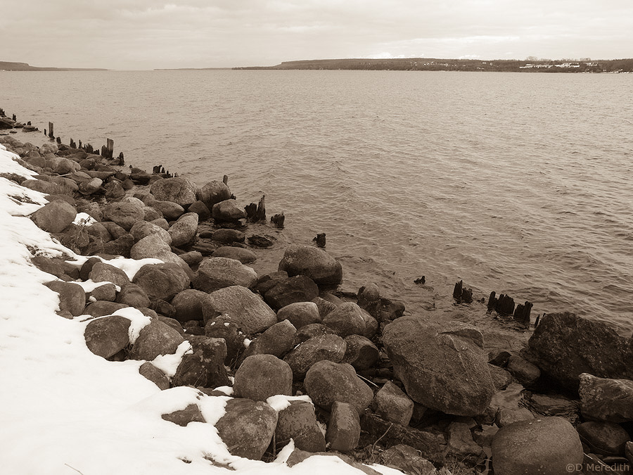 Snow on the shoreline.