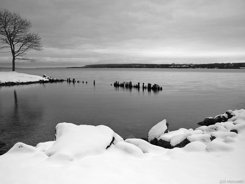 Snow on the shoreline.