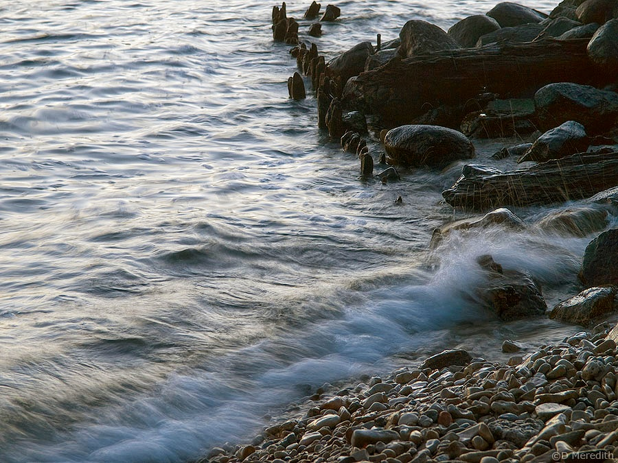 A wave breaking on the Colpoy's Bay shoreline.