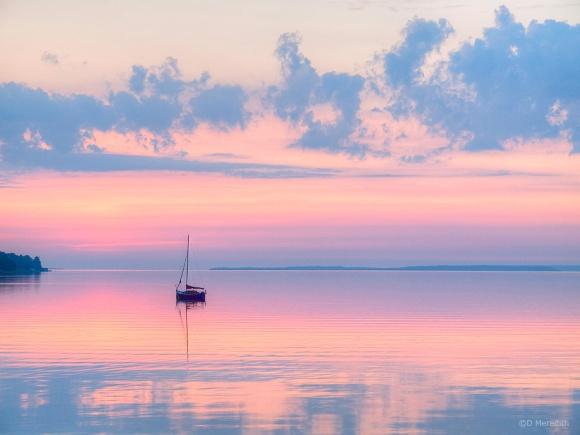 Sailboat at dawn.