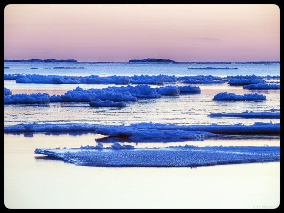Ice on Lake Huron at dusk.