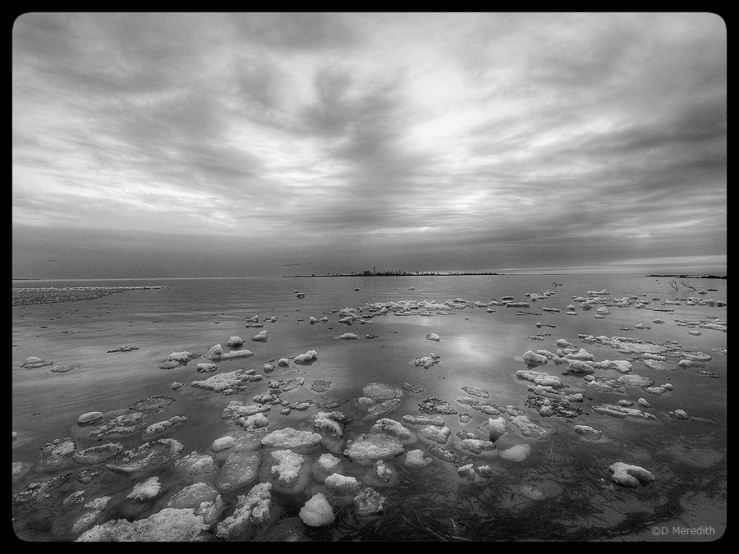 Chunks of ice on Lake Huron at dusk.