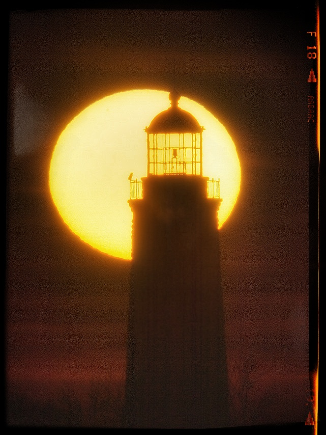 Lighthouse with setting sun.